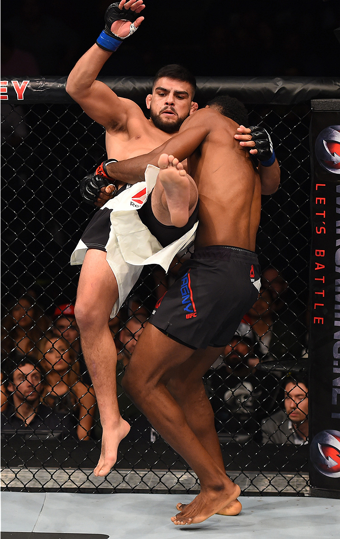 MONTERREY, MEXICO - NOVEMBER 21:  (R-L) Neil Magny of the United States takes down Kelvin Gastelum of the United States in their welterweight bout during the UFC Fight Night event at Arena Monterrey on November 21, 2015 in Monterrey, Mexico.  (Photo by Je