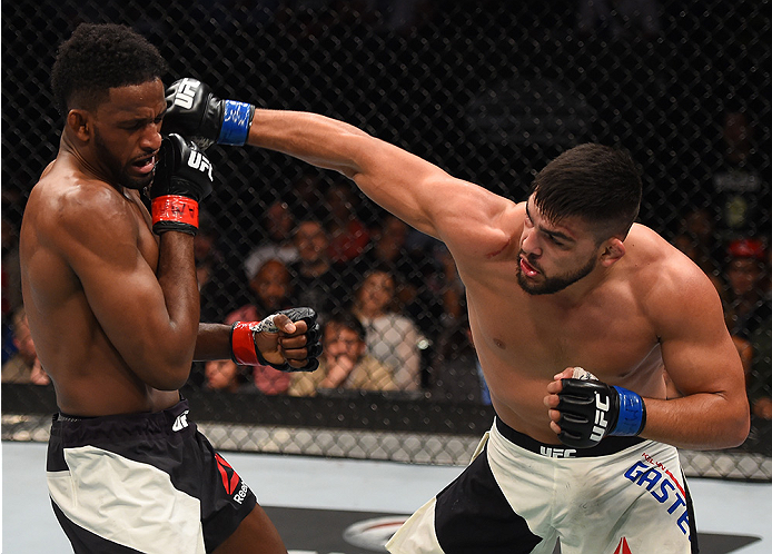 MONTERREY, MEXICO - NOVEMBER 21:  (R-L) Kelvin Gastelum of the United States punches Neil Magny of the United States in their welterweight bout during the UFC Fight Night event at Arena Monterrey on November 21, 2015 in Monterrey, Mexico.  (Photo by Jeff