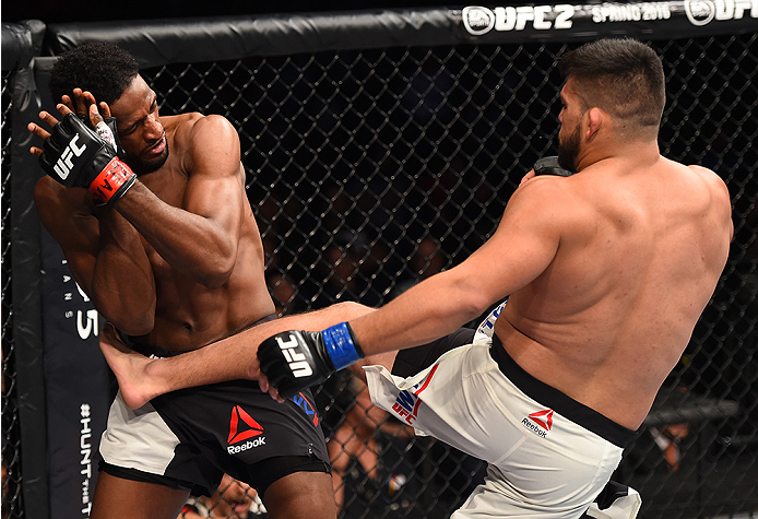 MONTERREY, MEXICO - NOVEMBER 21:  (R-L) Kelvin Gastelum of the United States kicks Neil Magny of the United States in their welterweight bout during the UFC Fight Night event at Arena Monterrey on November 21, 2015 in Monterrey, Mexico.  (Photo by Jeff Bo