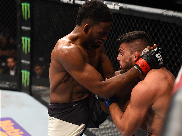 MONTERREY, MEXICO - NOVEMBER 21:  (L-R) Neil Magny of the United States knees Kelvin Gastelum of the United States in their welterweight bout during the UFC Fight Night event at Arena Monterrey on November 21, 2015 in Monterrey, Mexico.  (Photo by Jeff Bo