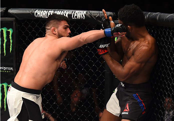MONTERREY, MEXICO - NOVEMBER 21:  (L-R) Kelvin Gastelum of the United States punches Neil Magny of the United States in their welterweight bout during the UFC Fight Night event at Arena Monterrey on November 21, 2015 in Monterrey, Mexico.  (Photo by Jeff