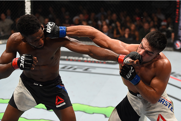 MONTERREY, MEXICO - NOVEMBER 21:  (L-R) Neil Magny of the United States and Kelvin Gastelum of the United States trade punches in their welterweight bout during the UFC Fight Night event at Arena Monterrey on November 21, 2015 in Monterrey, Mexico.  (Phot
