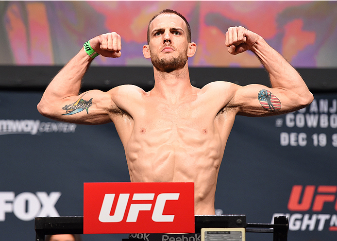 ORLANDO, FL - DECEMBER 18:   Cole Miller weighs in during the UFC weigh-in at the Orange County Convention Center on December 18, 2015 in Orlando, Florida. (Photo by Josh Hedges/Zuffa LLC/Zuffa LLC via Getty Images)