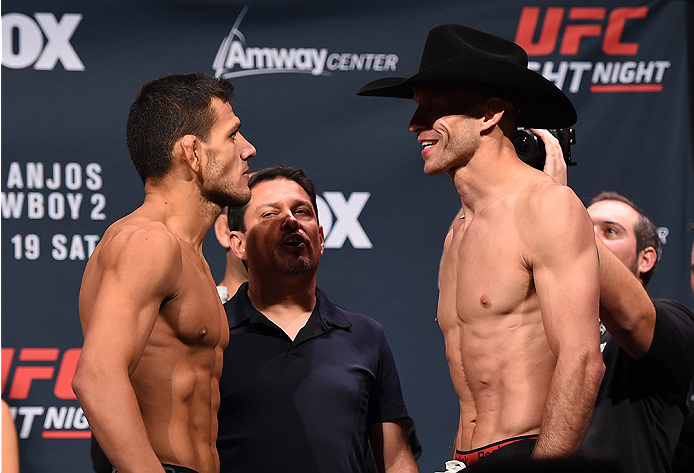 ORLANDO, FL - DECEMBER 18:  (L-R) Opponents Rafael dos Anjos of Brazil and Donald 'Cowboy' Cerrone face off during the UFC weigh-in at the Orange County Convention Center on December 18, 2015 in Orlando, Florida. (Photo by Josh Hedges/Zuffa LLC/Zuffa LLC