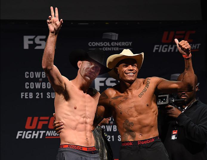 PITTSBURGH, PA - FEBRUARY 20:  (L-R) Donald Cerrone of the United States and Alex Oliveira of Brazil pose for the fans and media during the UFC Fight Night weigh-in at Stage AE on February 20, 2016 in Pittsburgh, Pennsylvania. (Photo by Jeff Bottari/Zuffa