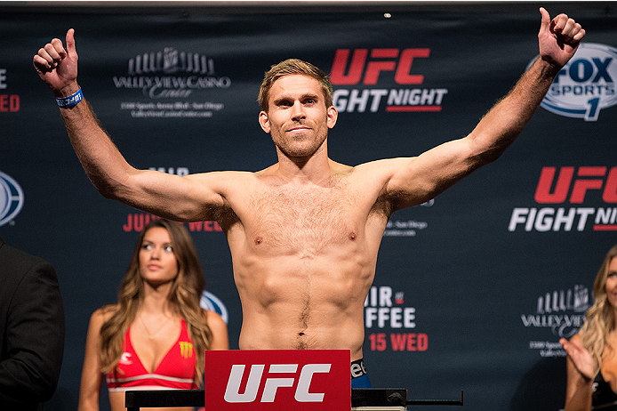 SAN DIEGO, CA - JULY 14:  Andrew Craig steps on the scale during the UFC weigh-in at the Valley View Casino Center on July 14, 2015 in San Diego, California. (Photo by Jeff Bottari/Zuffa LLC/Zuffa LLC via Getty Images)