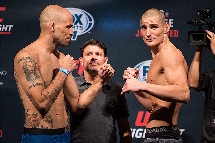 SAN DIEGO, CA - JULY 14:  (L-R) Igor Araujo of Brazil and Sean Strickland face-off during the UFC weigh-in at the Valley View Casino Center on July 14, 2015 in San Diego, California. (Photo by Jeff Bottari/Zuffa LLC/Zuffa LLC via Getty Images)