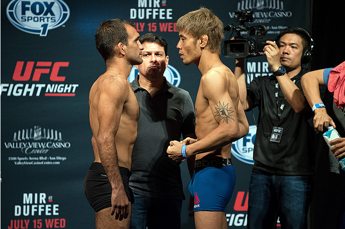 SAN DIEGO, CA - JULY 14:  (L-R) Rani Yahya of Brazil and Masanori Kanehara of Japan face-off during the UFC weigh-in at the Valley View Casino Center on July 14, 2015 in San Diego, California. (Photo by Jeff Bottari/Zuffa LLC/Zuffa LLC via Getty Images)