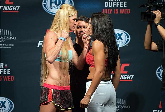 SAN DIEGO, CA - JULY 14:  (L-R) Holly Holm and Marion Reneau face-off during the UFC weigh-in at the Valley View Casino Center on July 14, 2015 in San Diego, California. (Photo by Jeff Bottari/Zuffa LLC/Zuffa LLC via Getty Images)