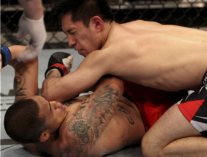 SINGAPORE - JANUARY 04:  Royston Wee lands an elbow on David Galera in their bantamweight bout during the UFC Fight Night event at the Marina Bay Sands Resort on January 4, 2014 in Singapore. (Photo by Mitch Viquez/Zuffa LLC/Zuffa LLC via Getty Images)