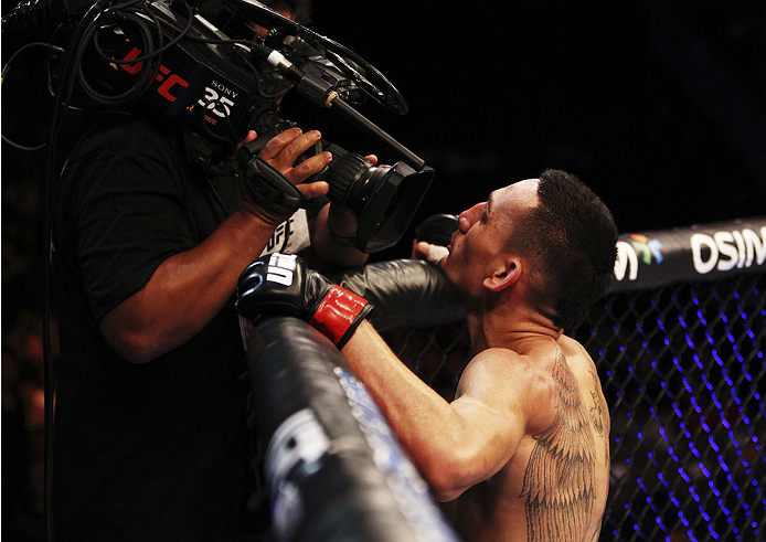 SINGAPORE - JANUARY 04:  Max Holloway celebrates his win over Will Chope in their featherweight bout during the UFC Fight Night event at the Marina Bay Sands Resort on January 4, 2014 in Singapore. (Photo by Mitch Viquez/Zuffa LLC/Zuffa LLC via Getty Imag