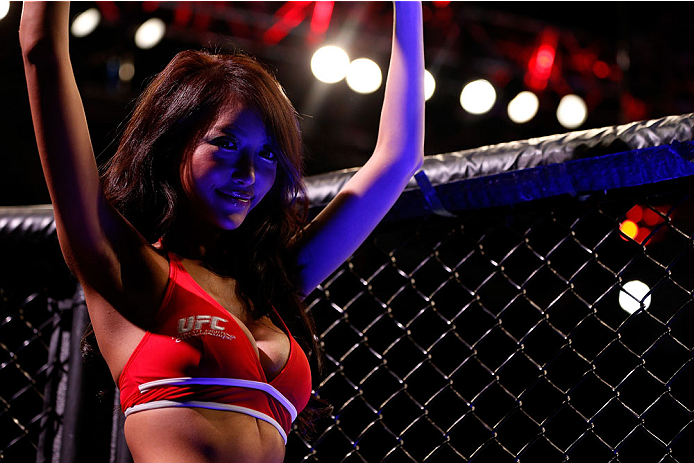 SINGAPORE - JANUARY 04:  UFC Octagon Girl Azusa Nishigaki introduces a round during the UFC Fight Night event at the Marina Bay Sands Resort on January 4, 2014 in Singapore. (Photo by Josh Hedges/Zuffa LLC/Zuffa LLC via Getty Images)
