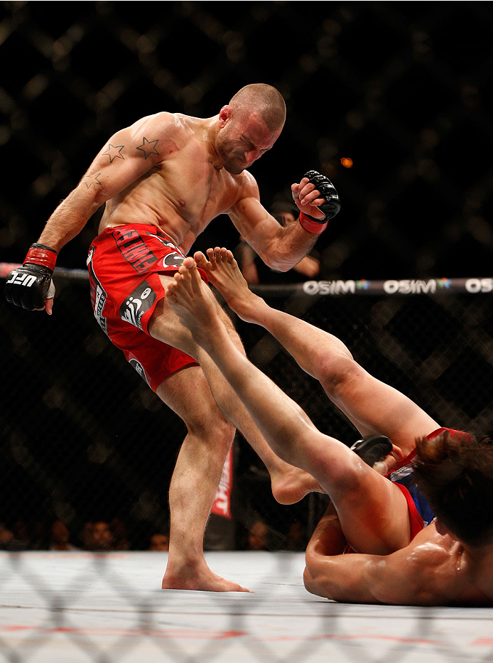 SINGAPORE - JANUARY 04:  (L-R) Tarec Saffiedine kicks Lim Hyun Gyu in their welterweight bout during the UFC Fight Night event at the Marina Bay Sands Resort on January 4, 2014 in Singapore. (Photo by Josh Hedges/Zuffa LLC/Zuffa LLC via Getty Images)
