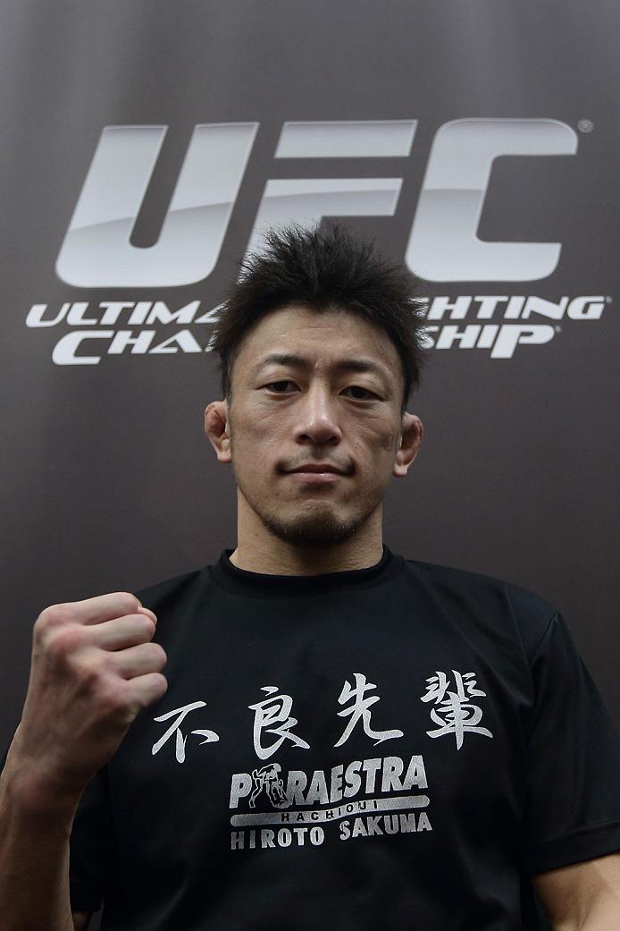 SINGAPORE - JANUARY 02:  Tatsuya Kawajiri poses for a photo during the UFC Fight Night Singapore Ultimate Media Day at the Skating Rink at The Shoppes at Marina Bay Sand on January 2, 2014 in Singapore.  (Photo by Suhaimi Abdullah/Zuffa LLC)