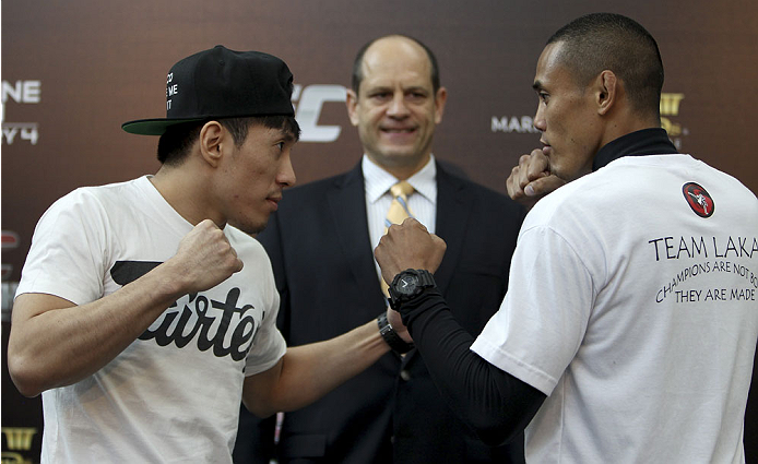 SINGAPORE - JANUARY 02:  (L-R) Opponents Royston Wee and David Galera face off during the UFC Fight Night Singapore Ultimate Media Day at the Shoppes at Marina Bay Sands on January 2, 2014 in Singapore. (Photo by Mitch Viquez/Zuffa LLC/Zuffa LLC via Getty