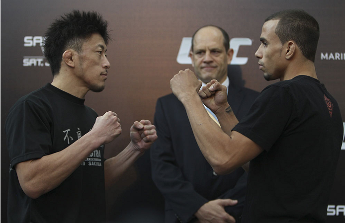 SINGAPORE - JANUARY 02:  (L-R) Opponents Tatsuya Kawajiri and Sean Soriano face off during the UFC Fight Night Singapore Ultimate Media Day at the Shoppes at Marina Bay Sands on January 2, 2014 in Singapore. (Photo by Mitch Viquez/Zuffa LLC/Zuffa LLC via