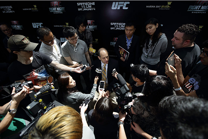 SINGAPORE - JANUARY 02:  Mark Fischer, managing director of UFC Asia, speaks to the media during the UFC Fight Night Singapore Ultimate Media Day at the Skating Rink at The Shoppes at Marina Bay Sand on January 2, 2014 in Singapore.  (Photo by Suhaimi Abd