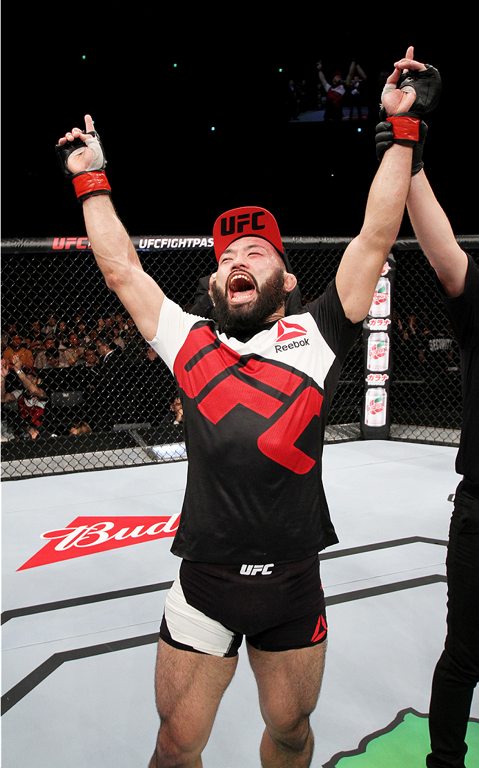 SAITAMA, JAPAN - SEPTEMBER 27: Shinsho Anzai of Japan celebrates his win over Roger Zapata of the Dominican Republic  in their welterweight bout during the UFC event at the Saitama Super Arena on September 27, 2015 in Saitama, Japan. (Photo by Mitch Vique