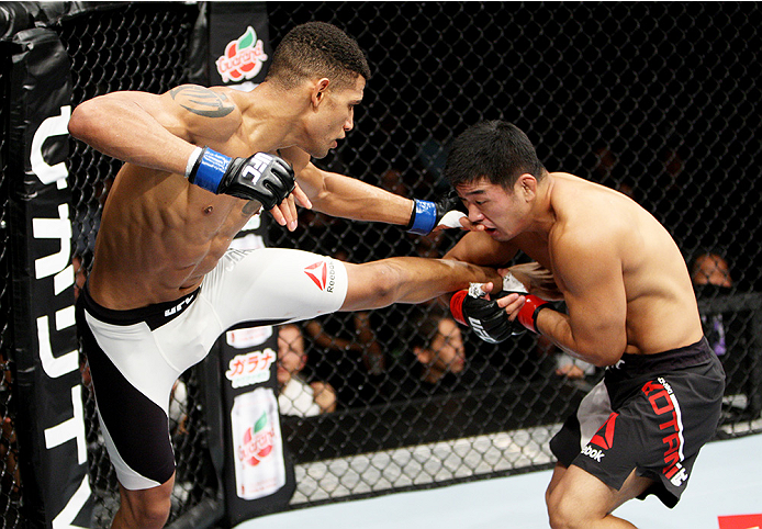 SAITAMA, JAPAN - SEPTEMBER 27:  Naoyuki Kotani of Japan catches a kick by Kajan Johnson of Canada  in their lightweight bout during the UFC event at the Saitama Super Arena on September 27, 2015 in Saitama, Japan. (Photo by Mitch Viquez/Zuffa LLC/Zuffa LL