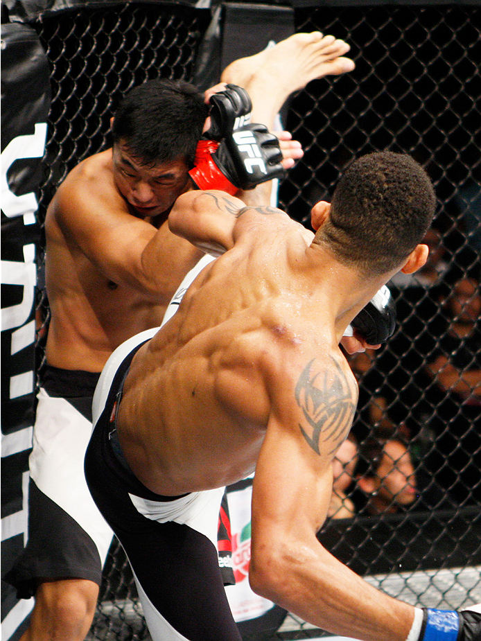 SAITAMA, JAPAN - SEPTEMBER 27:  Kajan Johnson of Canada goes for a kick on Naoyuki Kotani of Japan in their lightweight bout during the UFC event at the Saitama Super Arena on September 27, 2015 in Saitama, Japan. (Photo by Mitch Viquez/Zuffa LLC/Zuffa LL