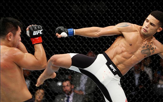 SAITAMA, JAPAN - SEPTEMBER 27: Kajan Johnson of Canada  goes fora kick on Naoyuki Kotani of Japan in their lightweight bout during the UFC event at the Saitama Super Arena on September 27, 2015 in Saitama, Japan. (Photo by Mitch Viquez/Zuffa LLC/Zuffa LLC