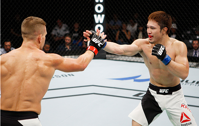 SAITAMA, JAPAN - SEPTEMBER 27:  (From L to R) Nick Hein of Germany and Yusuke Kasuya of Japan  slap hands  in their lightweight bout during the UFC event at the Saitama Super Arena on September 27, 2015 in Saitama, Japan. (Photo by Mitch Viquez/Zuffa LLC/