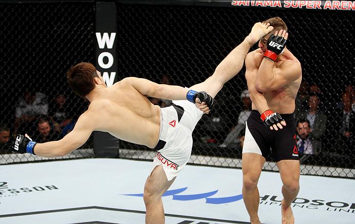 SAITAMA, JAPAN - SEPTEMBER 27:  Yusuke Kasuya of Japan kicks Nick Hein of Germany in their lightweight bout during the UFC event at the Saitama Super Arena on September 27, 2015 in Saitama, Japan. (Photo by Mitch Viquez/Zuffa LLC/Zuffa LLC via Getty Image