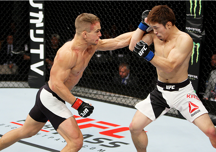 SAITAMA, JAPAN - SEPTEMBER 27: Nick Hein of Germany punches Yusuke Kasuya of Japan  in their lightweight bout during the UFC event at the Saitama Super Arena on September 27, 2015 in Saitama, Japan. (Photo by Mitch Viquez/Zuffa LLC/Zuffa LLC via Getty Ima