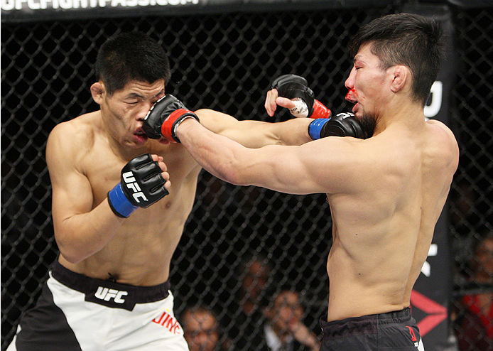SAITAMA, JAPAN - SEPTEMBER 27: (From L to R) Li Jingliang of China and Keita Nakamura of Japan look for openings in their welterweight bout during the UFC event at the Saitama Super Arena on September 27, 2015 in Saitama, Japan. (Photo by Mitch Viquez/Zuf