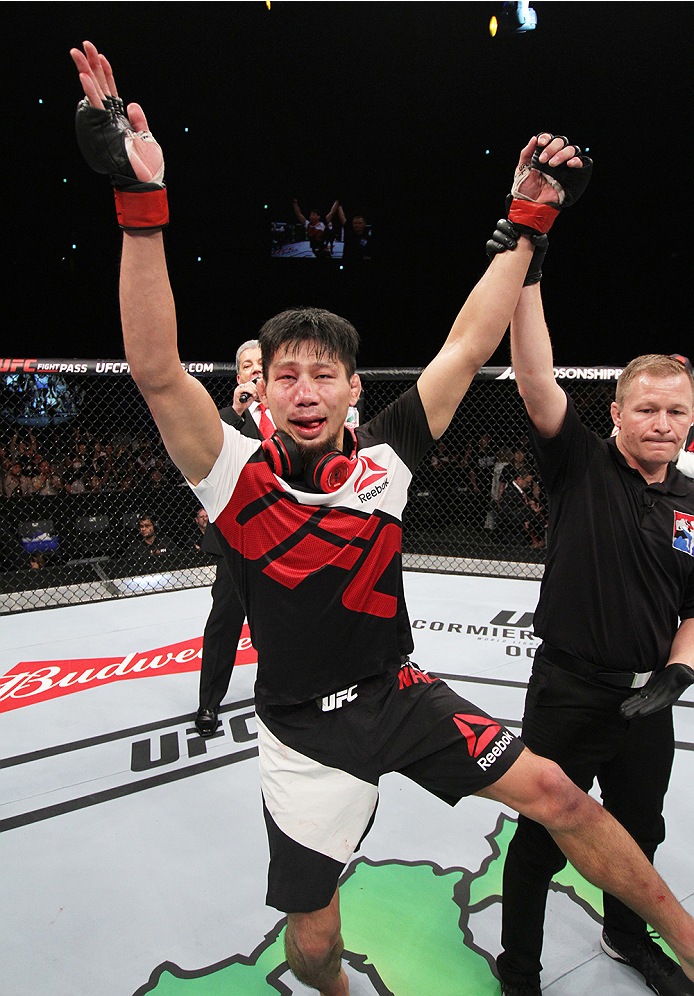 SAITAMA, JAPAN - SEPTEMBER 27: Keita Nakamura of Japan celebrates his win over Li Jingliang of China  in their welterweight bout during the UFC event at the Saitama Super Arena on September 27, 2015 in Saitama, Japan. (Photo by Mitch Viquez/Zuffa LLC/Zuff