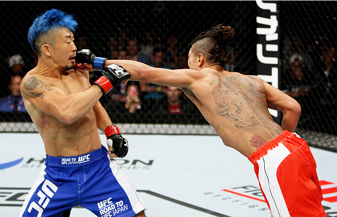 SAITAMA, JAPAN - SEPTEMBER 27: Teruto Ishihara of Japan punches Mizuto Hirota of Japan  in their featherweight bout during the UFC event at the Saitama Super Arena on September 27, 2015 in Saitama, Japan. (Photo by Mitch Viquez/Zuffa LLC/Zuffa LLC via Get