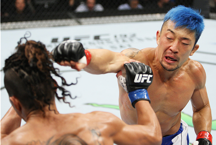 SAITAMA, JAPAN - SEPTEMBER 27:  Mizuto Hirota of Japan punches Teruto Ishihara of Japan in their featherweight bout during the UFC event at the Saitama Super Arena on September 27, 2015 in Saitama, Japan. (Photo by Mitch Viquez/Zuffa LLC/Zuffa LLC via Get