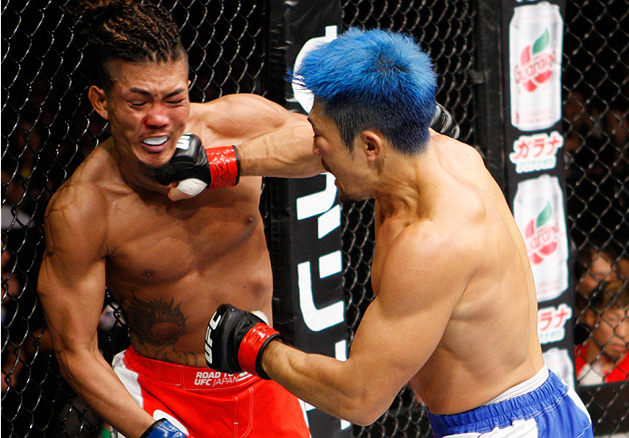 SAITAMA, JAPAN - SEPTEMBER 27: (From L to R) Teruto Ishihara of Japan and Mizuto Hirota of Japan exchange punches in their featherweight bout during the UFC event at the Saitama Super Arena on September 27, 2015 in Saitama, Japan. (Photo by Mitch Viquez/Z