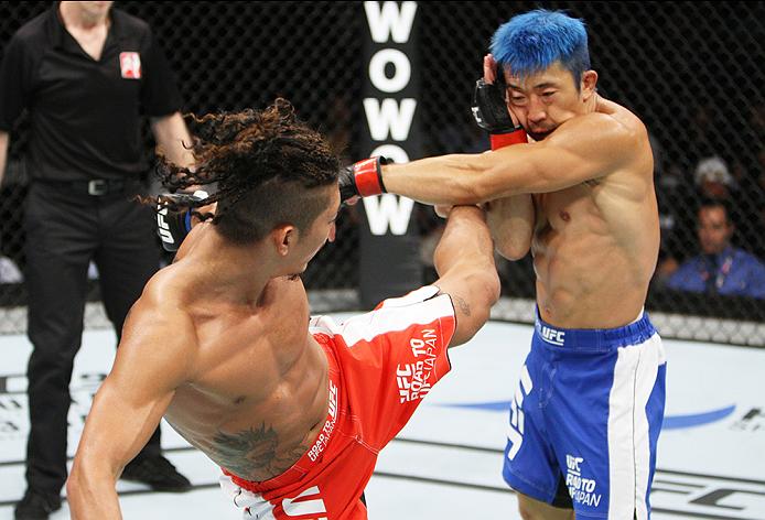 SAITAMA, JAPAN - SEPTEMBER 27: Teruto Ishihara of Japan kicks Mizuto Hirota of Japan  in their featherweight bout during the UFC event at the Saitama Super Arena on September 27, 2015 in Saitama, Japan. (Photo by Mitch Viquez/Zuffa LLC/Zuffa LLC via Getty
