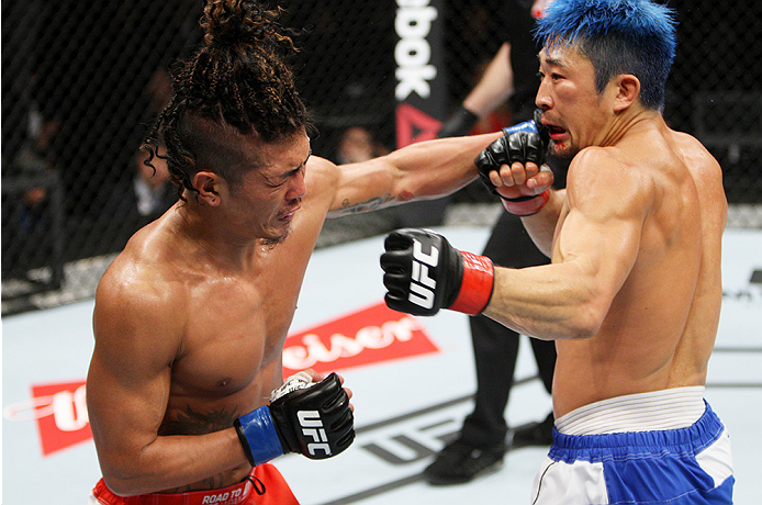 SAITAMA, JAPAN - SEPTEMBER 27: (From L to R) Teruto Ishihara of Japan and Mizuto Hirota of Japan  exchange punches in their featherweight bout during the UFC event at the Saitama Super Arena on September 27, 2015 in Saitama, Japan. (Photo by Mitch Viquez/