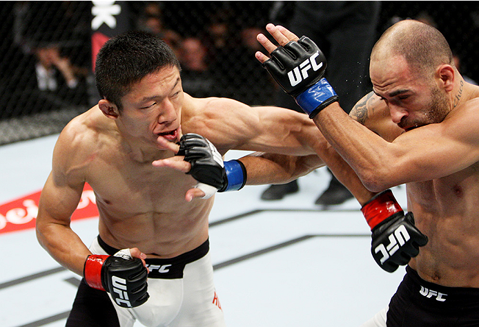 SAITAMA, JAPAN - SEPTEMBER 27:  (From L to R) Kyoji Horiguchi of Japan and Chico Camus of the United States of America exchange punches in their flyweight bout during the UFC event at the Saitama Super Arena on September 27, 2015 in Saitama, Japan. (Photo
