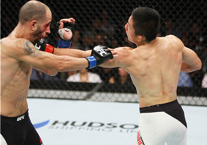 SAITAMA, JAPAN - SEPTEMBER 27: Kyoji Horiguchi of Japan punches Chico Camus of the United States of America in their flyweight bout during the UFC event at the Saitama Super Arena on September 27, 2015 in Saitama, Japan. (Photo by Mitch Viquez/Zuffa LLC/Z