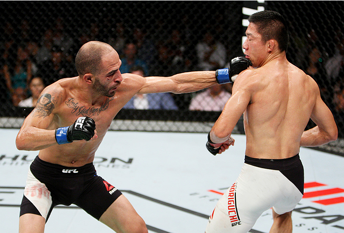 SAITAMA, JAPAN - SEPTEMBER 27:  Chico Camus of the United States of America punches Kyoji Horiguchi of Japan in their flyweight bout during the UFC event at the Saitama Super Arena on September 27, 2015 in Saitama, Japan. (Photo by Mitch Viquez/Zuffa LLC/