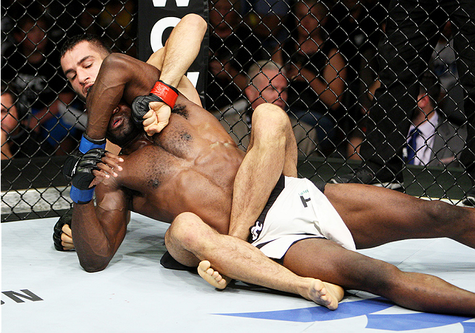 SAITAMA, JAPAN - SEPTEMBER 27: Gegard Mousaasi of Iran punches Uriah Hall of Jamaica in their middleweight bout during the UFC event at the Saitama Super Arena on September 27, 2015 in Saitama, Japan. (Photo by Mitch Viquez/Zuffa LLC/Zuffa LLC via Getty I