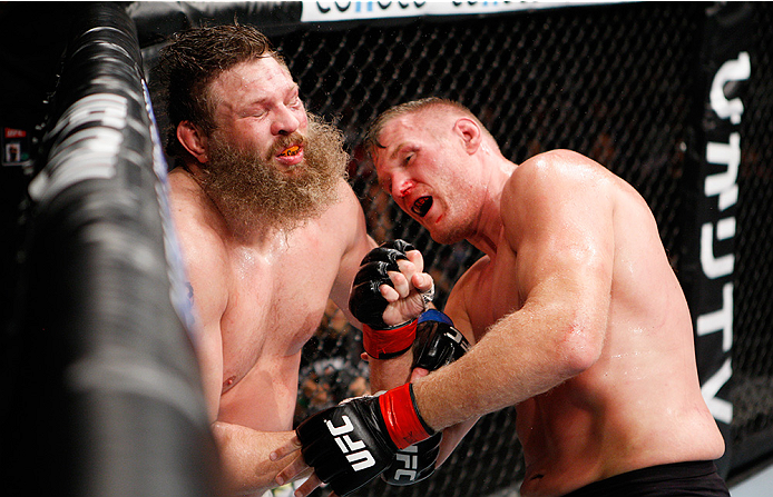 SAITAMA, JAPAN - SEPTEMBER 27: Josh Barnett of the United States of America punches Roy Nelson of the United States of America in their heavyweight bout during the UFC event at the Saitama Super Arena on September 27, 2015 in Saitama, Japan. (Photo by Mit