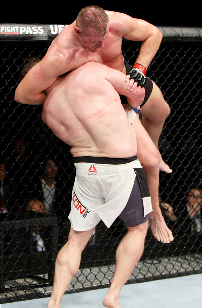SAITAMA, JAPAN - SEPTEMBER 27:  Roy Nelson of the United States of America looks for a takedown on Josh Barnett of the United States of America in their heavyweight bout during the UFC event at the Saitama Super Arena on September 27, 2015 in Saitama, Jap