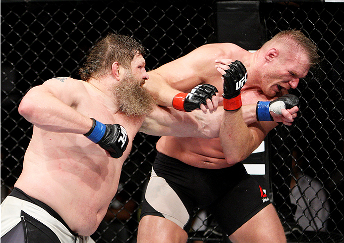 SAITAMA, JAPAN - SEPTEMBER 27: Roy Nelson of the United States of America punches Josh Barnett of the United States of America in their heavyweight bout during the UFC event at the Saitama Super Arena on September 27, 2015 in Saitama, Japan. (Photo by Mit