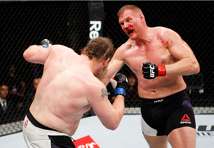 SAITAMA, JAPAN - SEPTEMBER 27:  (From L to R) Roy Nelson of the United States of America and Josh Barnett of the United States of America exchange punches in their heavyweight bout during the UFC event at the Saitama Super Arena on September 27, 2015 in S
