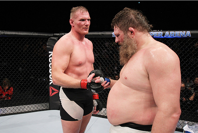 SAITAMA, JAPAN - SEPTEMBER 27: (From L to R) Josh Barnett of the United States of America and Roy Nelson of the United States of America shake hands after their heavyweight bout during the UFC event at the Saitama Super Arena on September 27, 2015 in Sait