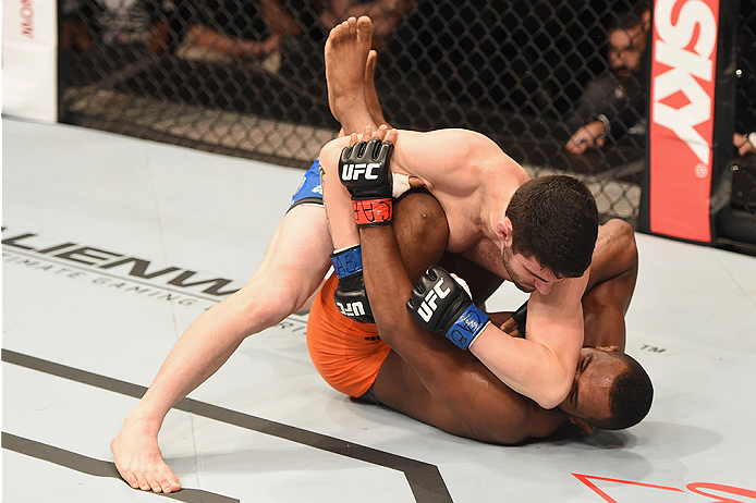 UBERLANDIA, BRAZIL - NOVEMBER 08:  Leandro Silva of Brazil punches Charlie Brenneman of the United States  in their lightweight bout during the UFC Fight Night at Sabiazinho Gymnasium on November 8, 2014 in Uberlandia, Brazil.  (Photo by Buda Mendes/Zuffa