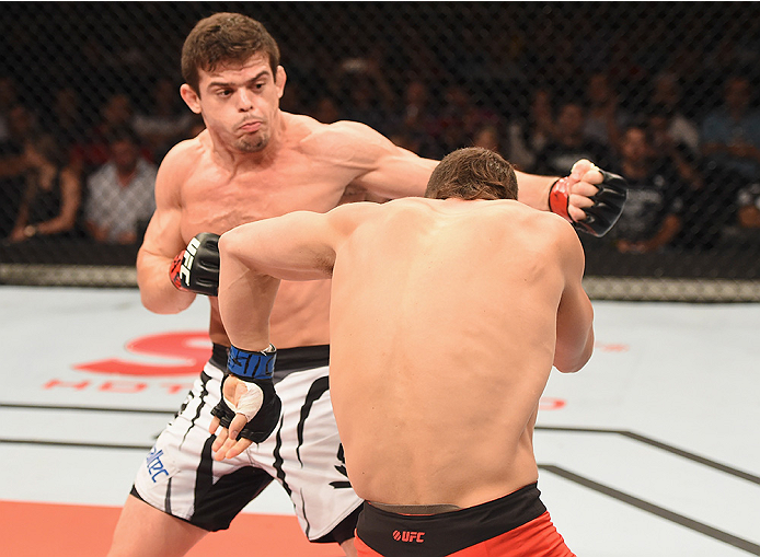 UBERLANDIA, BRAZIL - NOVEMBER 08:  Caio Magalhaes of Brazil punches Trevor Smith of the United States  in their middleweight bout during the UFC Fight Night at Sabiazinho Gymnasium> on November 8, 2014 in Uberlandia, Brazil.  (Photo by Buda Mendes/Zuffa L