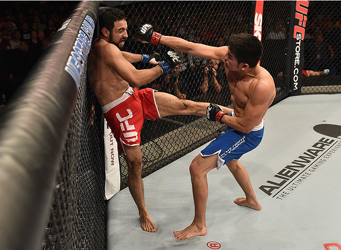 UBERLANDIA, BRAZIL - NOVEMBER 08:  Diego Rivas of Chile punches Rodolfo Rubio of Mexico  in their featherweight bout during the UFC Fight Night at Sabiazinho Gymnasium on November 8, 2014 in Uberlandia, Brazil.  (Photo by Buda Mendes/Zuffa LLC/Zuffa LLC v