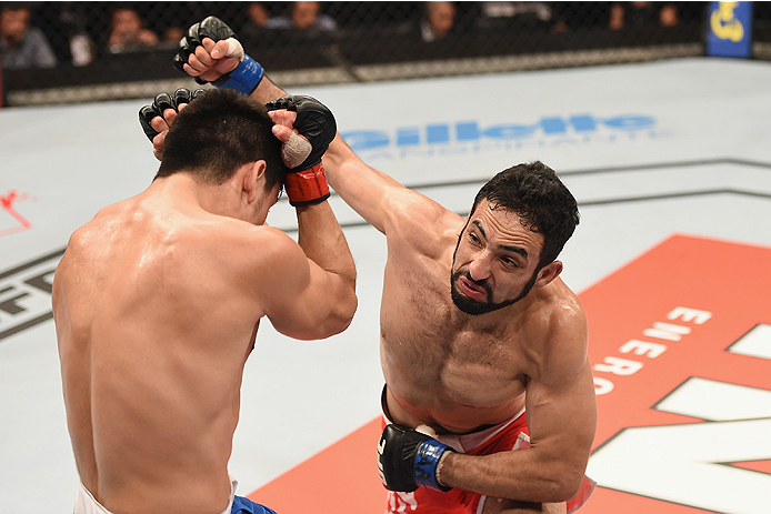 UBERLANDIA, BRAZIL - NOVEMBER 08:  Rodolfo Rubio of Mexico punches Diego Rivas of Chile in their featherweight bout during the UFC Fight Night at Sabiazinho Gymnasium on November 8, 2014 in Uberlandia, Brazil.  (Photo by Buda Mendes/Zuffa LLC/Zuffa LLC vi