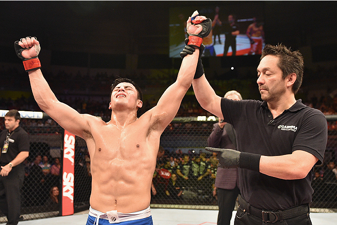 UBERLANDIA, BRAZIL - NOVEMBER 08:  Diego Rivas of Chile celebrates his victory over Rodolfo Rubio of Mexico  in their featherweight bout during the UFC Fight Night at Sabiazinho Gymnasium on November 8, 2014 in Uberlandia, Brazil.  (Photo by Buda Mendes/Z