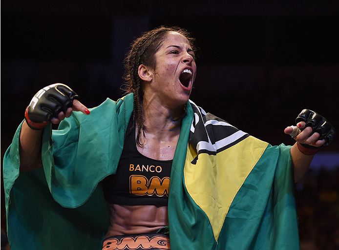 UBERLANDIA, BRAZIL - NOVEMBER 08:  Juliana Lima of Brazil celebrates after her victory over Nina Ansaroff of the United States in their strawweight bout during the UFC Fight Night at Sabiazinho Gymnasium on November 8, 2014 in Uberlandia, Brazil.  (Photo